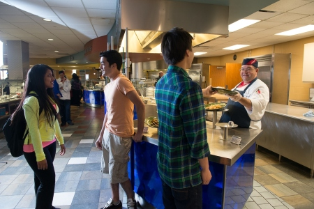 """University of Wisconsin-Parkside students in the campus' main cafeteria, the """"Brickstone"""" enjoy entrees prepared while they wait, a salad bar and a great assortment of drinks and fruit."""